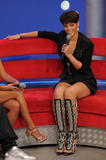 Rihanna shows her legs in black mini dress on BET's 106 & Park at the BET Studios in New York City