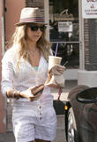 http://img104.imagevenue.com/loc250/th_90359_Ashley_Tisdale_leaving_Coffee_Bean_in_Los_Angeles_290708_10_123_250lo.jpg