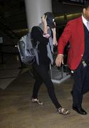Charlize Theron At LAX 07-02-2011
